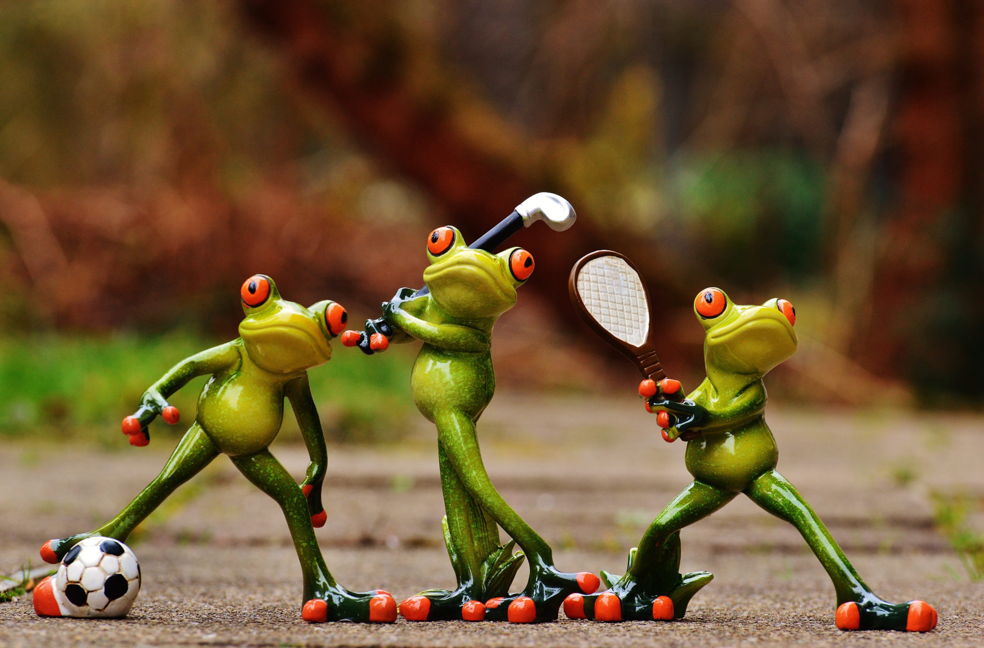 Frog figures playing sport